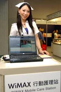 A model displays a laptop computer equipped with WiMAX technology. See more laptop pictures.