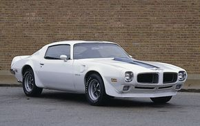 With the introduction of the second-generation Firebird, the 1970 Pontiac Trans Am came into its own as a bare-knuckles brawler. Functional spoilers                                            and vents abounded, while super-tough underpinnings and                                            quickened steering gave it corner-hungry handling. See more muscle car pictures.