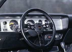 The Pontiac Trans Am's padded Formula steering wheel directed quick 12.1:1 variable-ratio power steering. The interior had a seriously sporty ambience.