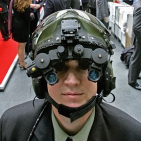 A man demonstrates night vision goggles at the 'Building a Secure World Convention' in London.